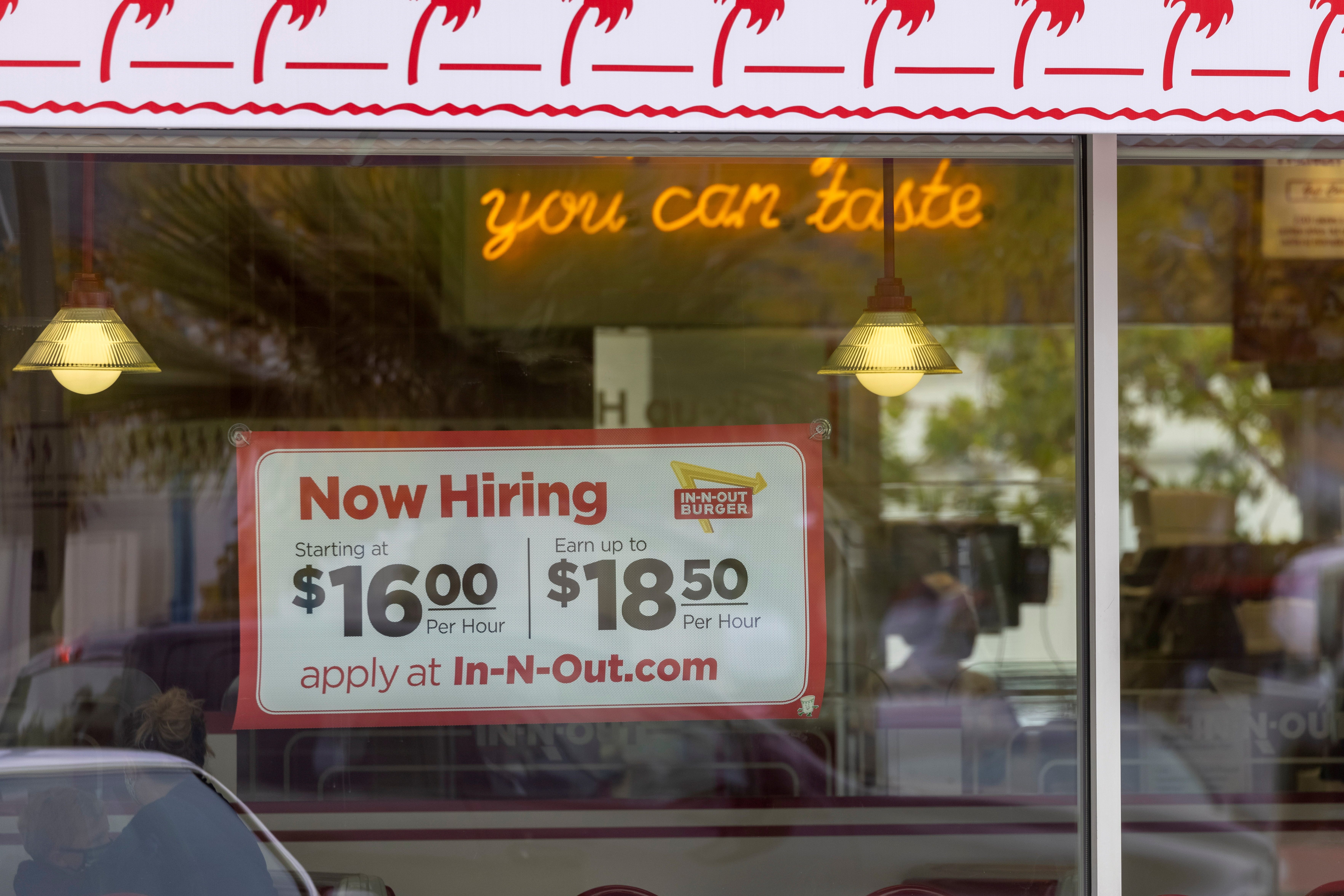 An In-N-Out Burger advertises for workers at their restaurants location in Encinitas, California, U.S., May 10, 2021. REUTERS/Mike Blake/File Photo