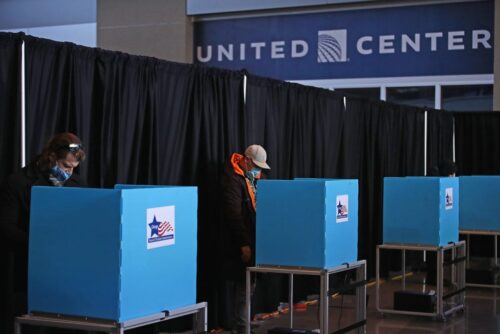 Voters use socially distanced machines in the United Center for the first time Nov. 3, 2020, in Chicago.