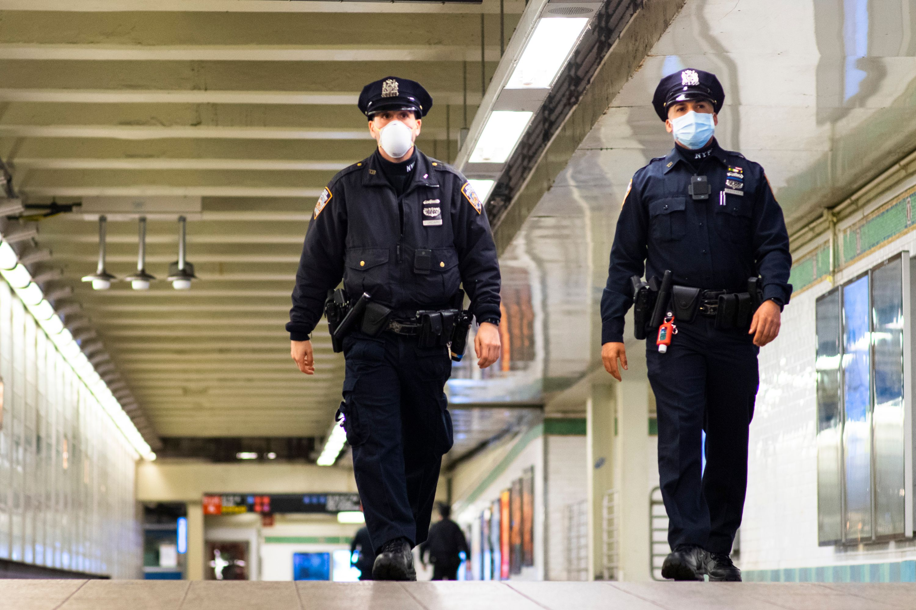 Police officers patrol the New York City subway in May 2020.