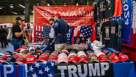 People view merchandise during the Conservative Political Action Conference held on July 10, 2021, in Dallas.