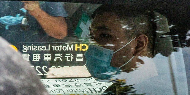 Tong Ying-kit, who is accused of deliberately driving his motorcycle into a group of police officers on July 1, arrives at the West Kowloon court in Hong Kong on July 6, 2020. - Tong, 23, charged with inciting secession and one charge of terrorism, became the first person in Hong Kong on July 3 to be charged under Beijing's sweeping new national security law. (Photo by ISAAC LAWRENCE / AFP) (Photo by ISAAC LAWRENCE/AFP via Getty Images)