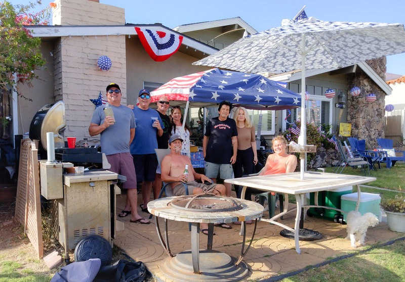 Ricardo Ghionzoli, Jamie Mack, Tom Mack, Lorine Christensen, Leslie Drinco, Dave Drinco, Chip McCarty and Chris Deatrick are all residents in the 800 block of Wilbur Avenue in Pacific Beach who annually demonstrate their independent spirit hosting a block party for the 4th of July. DAVE SCHWAB/PENINSULA BEACON