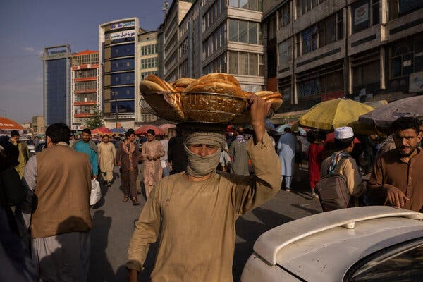 Selling bread on a street in Kabul on Saturday.